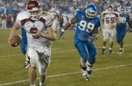 Arkansas quarterback Matt Jones (9) outruns Kentucky defensive lineman Ellery Moore (99) for a touchdown during the fourth overtime of a game Saturday, Nov. 1, 2003, in Lexington, Ky. The Razorbacks defeated the Wildcats 71-63 in seven overtimes, which is tied for the longest overtime game in NCAA history.