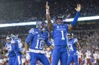 Kentucky quarterback Lynn Bowden Jr. celebrates after scoring a touchdown during the second quarter of a game against Arkansas on Saturday, Oct. 12, 2019, in Lexington, Ky.