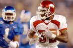 Arkansas running back DeCori Birmingham runs during a game against Kentucky on Saturday, Nov. 1, 2003, in Lexington, Ky. Birmingham rushed for 196 yards as the Razorbacks defeated the Wildcats 71-63 in seven overtimes.