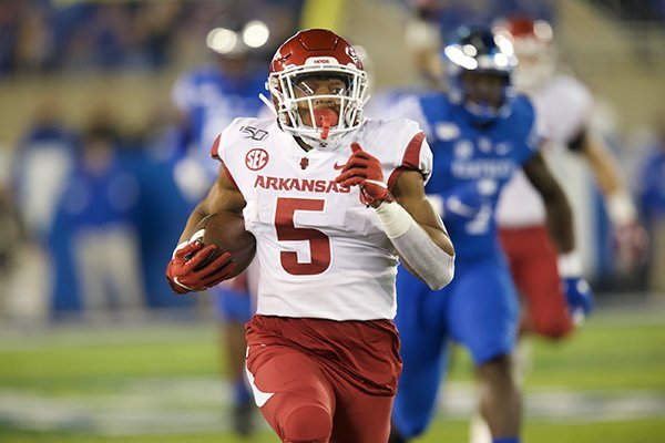 Arkansas running back Rakeem Boyd (5) runs for a touchdown during the first quarter of a game against Kentucky on Saturday, Oct. 12, 2019, in Lexington, Ky.