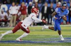 Kentucky quarterback Lynn Bowden Jr. (1) scrambles from an Arkansas defender during the second half of an NCAA college football game Saturday, Oct. 12, 2019, in Lexington, Ky. (AP Photo/Bryan Woolston)
