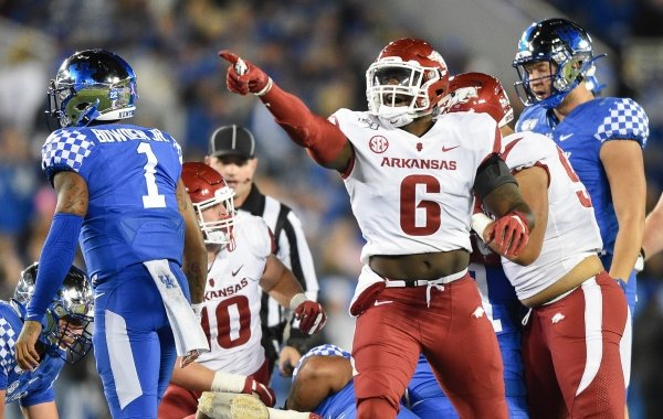 Arkansas defensive lineman Gabe Richardson (6) reacts after a fumble recovery Saturday, October 12, 2019 during the first quarter of a football game at Kroger Field in Lexington, Ky. Visit nwadg.com/photos to see more photographs from the game.