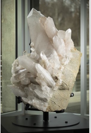 """The Holy Grail"" is the name given to a five-foot tall crystal cluster pulled from the ground by miners working the Zigras Mine in Blue Springs near Hot Springs in 1931. Considered the single most important quartz specimen mined in America, it is estimated to weigh about 1,500 pounds. (Courtesy Crystal Bridges Museum of American Art)"