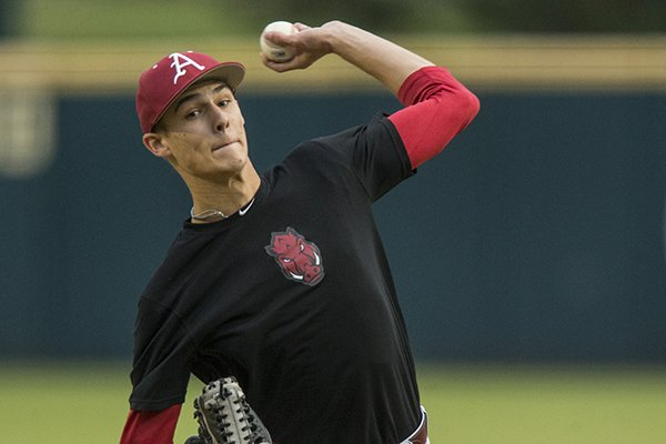 Arkansas pitcher Caden Monke throws a pitch Thursday, Oct. 18, 2018, during a scrimmage in Fayetteville.