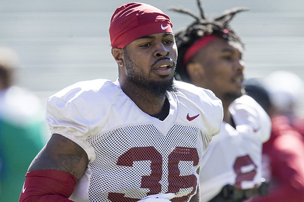 Arkansas linebacker D'Vone McClure runs onto the field for a practice Saturday, March 9, 2019, in Fayetteville.