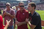 From left, Arkansas women's basketball coach Mike Neighbors, baseball coach Dave Van Horn and men's basketball coach Eric Musselman are shown prior to a Razorbacks football game against Colorado State on Saturday, Sept. 14, 2019, in Fayetteville.