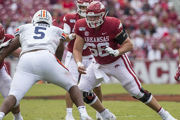 Arkansas center Ty Clary (66) blocks Auburn defensive tackle Derrick Brown (5) during a game Saturday, Oct. 19, 2019, in Fayetteville.