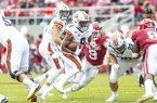 Auburn running back Kam Martin (9) carries the ball during a game against Arkansas on Saturday, Oct. 19, 2019, in Fayetteville.