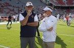 Auburn coach Gus Malzahn (left) and Arkansas coach Chad Morris speak prior to a game Saturday, Oct. 19, 2019, in Fayetteville.