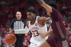 Arkansas' Jimmy Whitt Jr. looks for room to get around Arkansas-Little Rock's Jaizec Lottie Sunday Oct. 20, 2019 at Bud Walton Arena win Fayetteville. The Razorbacks beat the Trojans 79-64.