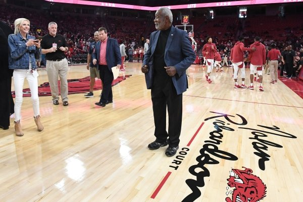 Former head coach for the Razorbacks basketball team Nolan Richardson poses for photos Sunday, Oct. 20, 2019, after the court at Bud Walton Arena in Fayetteville was named after Richardson. The court will now be known as Nolan Richardson Court.