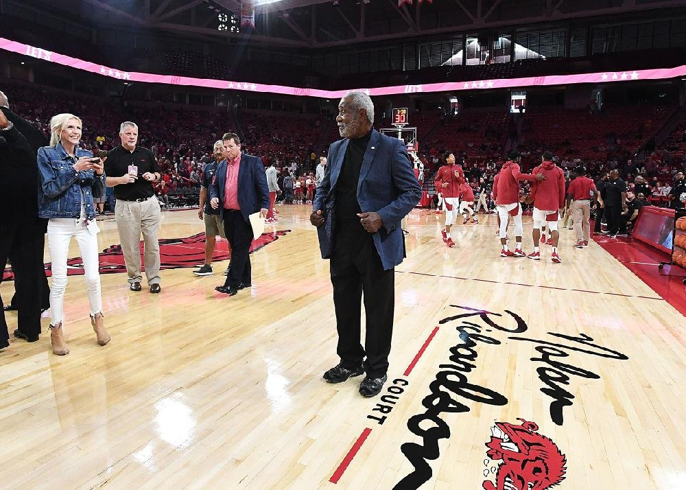 NWA Democrat-Gazette/J.T.WAMPLER Former head coach for the Razorback basketball team Nolan Richardson poses for photos Sunday Oct. 20, 2019 after the court at Bud Walton Arena in Fayetteville was named after Richardson. The court will now be known as the Nolan Richardson Court.