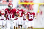 Arkansas players take the field prior to a game against Auburn on Saturday, Oct. 19, 2019, in Fayetteville.