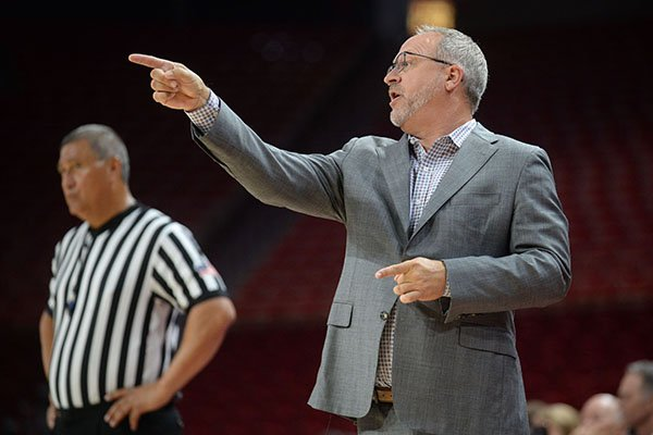 Arkansas coach Mike Neighbors directs his players against Pittsburg State Thursday, Oct. 24, 2019, during the second half of play in Bud Walton Arena.