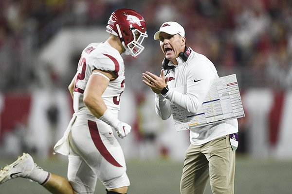 Arkansas coach Chad Morris claps as fullback Hayden Johnson (32) runs off the field during a game against Alabama on Saturday, Oct. 26, 2019, in Tuscaloosa, Ala.
