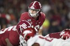 Alabama quarterback Mac Jones (10) lines up under center during a game against Arkansas on Saturday, Oct. 26, 2019, in Tuscaloosa, Ala.