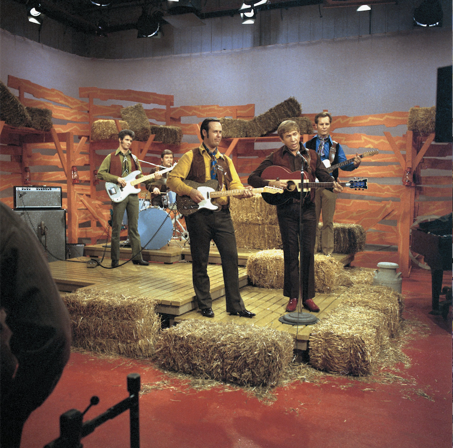 """Buck Owens and the Buckaroos were regulars on TV's """"Hee Haw."""" Pictured in this undated photo are (from left) Doyle Curtsinger, Jerry Wiggins, Don Rich, Buck Owens and Doyle Holly. (Courtesy Bear Family Records)"""