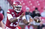 Arkansas quarterback K.J. Jefferson takes a snap during a game against Mississippi State on Saturday, Nov. 2, 2019, in Fayetteville.