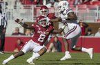 Mississippi State running back Kylin Hill (8, white) stiff arms Arkansas linebacker De'Jon Harris (8, red) during a game Saturday, Nov. 2, 2019, in Fayetteville.