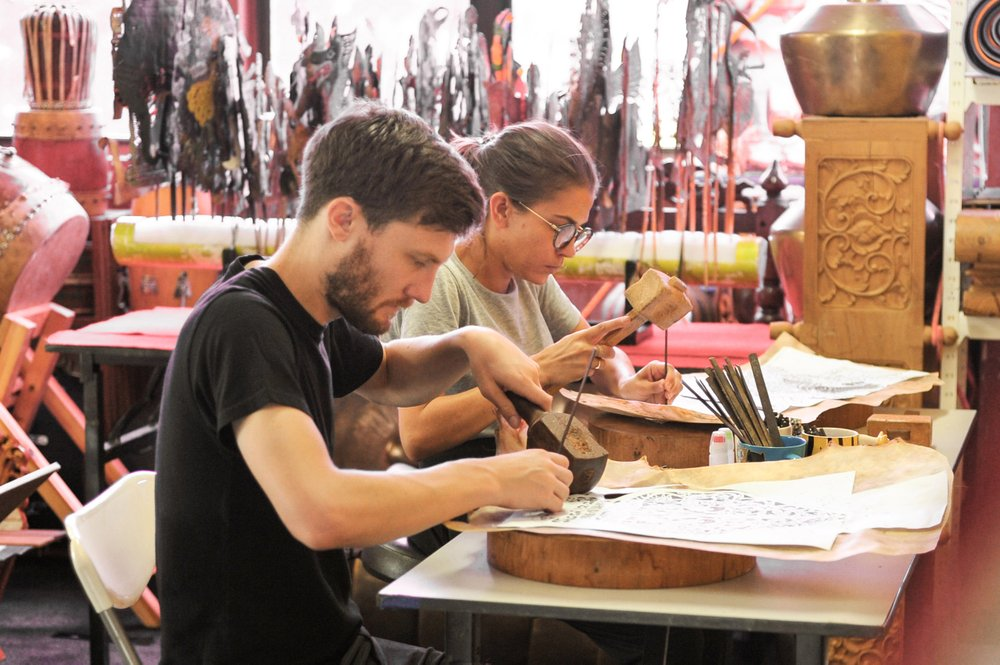 Vacation with an Artist helps individuals or small groups book mini apprenticeships with craftspeople like a Malaysian leather puppet carver. MUST CREDIT: Vacation With an Artist handout photo