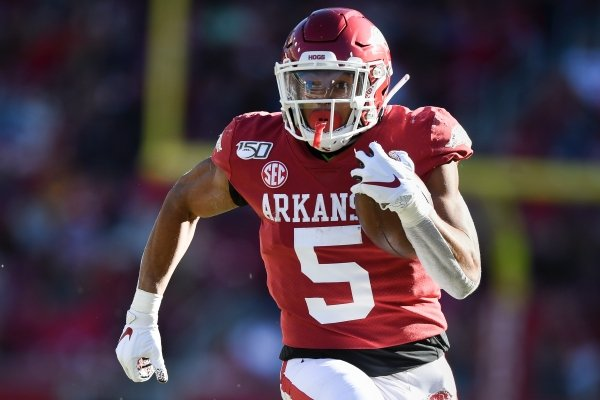 Arkansas running back Rakeem Boyd (5) carries the ball for a 52-yard touchdown during a game against Mississippi State on Saturday, Nov. 2, 2019, in Fayetteville.