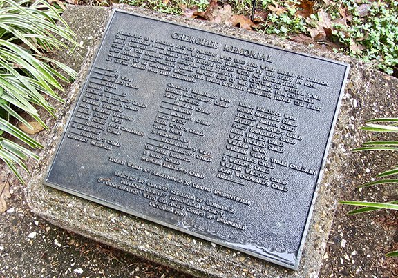A plaque at Cadron Settlement Park lists the names of Cherokee victims of cholera who died there while being transported west. (Photo by Marcia Schnedler, special to the Democrat-Gazette)