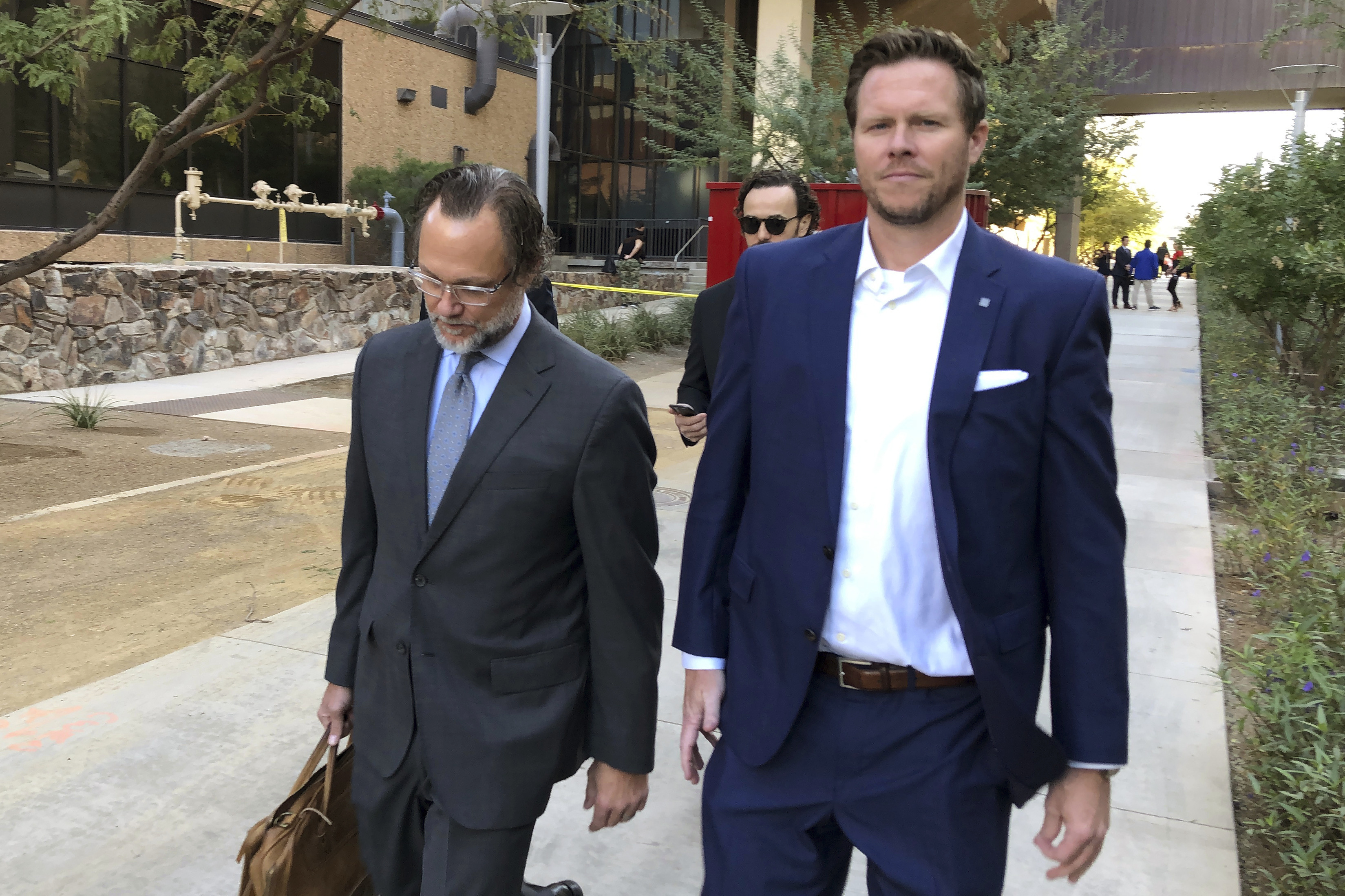 Arizona official charged in adoption scheme gets Dec. 11 hearing to contest suspension