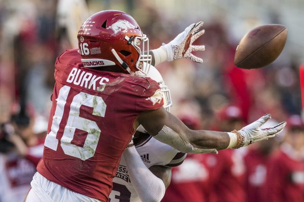 Treylon Burks, Arkansas wide receiver, makes a catch under pressure from Cameron Dantzler, Mississippi State cornerback, in the fourth quarter Saturday, Nov. 2, 2019, at Reynolds Razorback Stadium in Fayetteville.