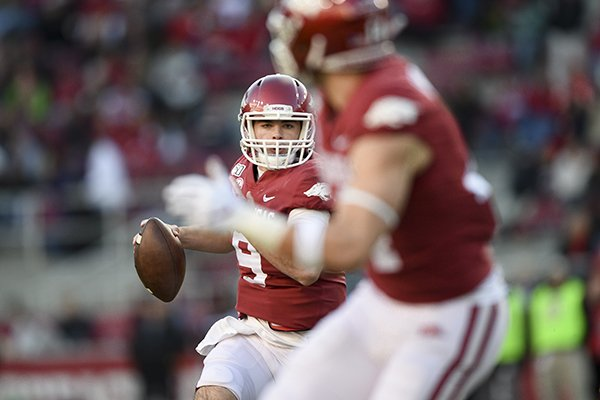 Arkansas quarterback John Stephen Jones looks to throw a pass during a game against Mississippi State on Saturday, Nov. 2, 2019, in Fayetteville.