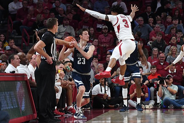 Arkansas guard Desi Sills (3) defends as Rice guard Drew Peterson (23) tries to inbound during a game Tuesday, Nov. 5, 2019, in Fayetteville.