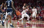 Arkansas guard Jimmy Whitt (33) defends as Rice guard Ako Adams brings the ball up the floor during a game Tuesday, Nov. 5, 2019, in Fayetteville.