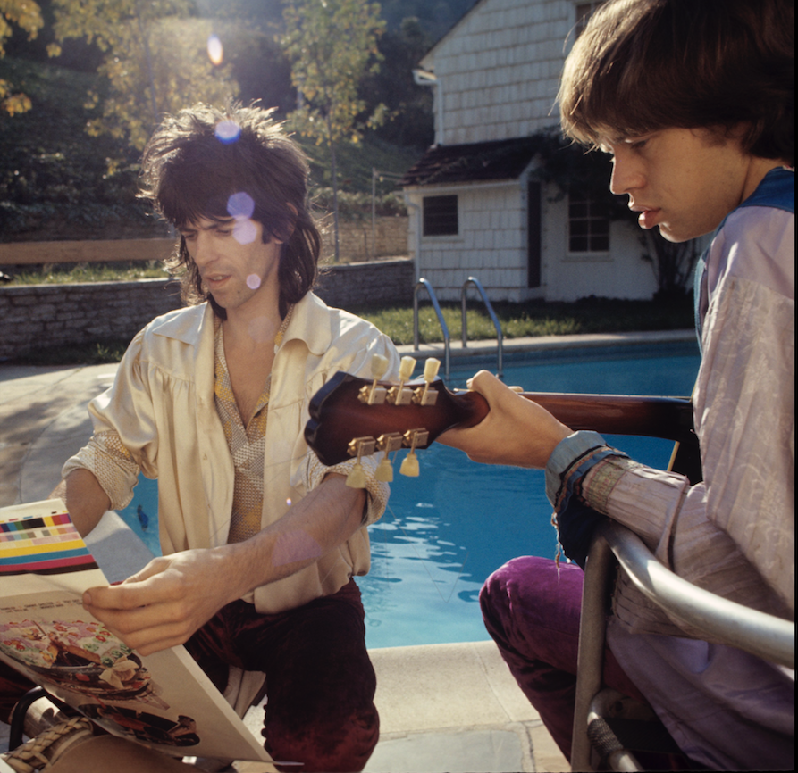 "Keith Richards (left) and Mick Jagger review the cover art for 1969's Rolling Stones album ""Let It Bleed."" (ETHAN RUSSELL/Courtesy ABKCO Records)"