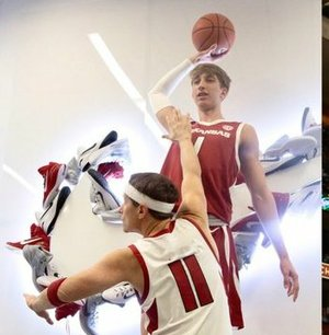 2022 guard Joseph Pinion plays the role of LeBron James while dunking on Coach Eric Musselman, who plays the role of former guard Jason Terry.