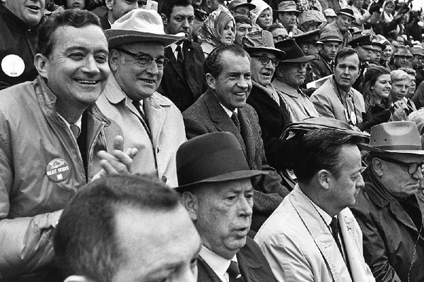 President Richard Nixon (center) watches with other dignitaries during the game between No. 1 Texas and No. 2 Arkansas at Razorback Stadium in Fayetteville on Dec. 6, 1969. Texas won 15-14. On Saturday, nearly 50 years later, President Donald Trump will attend the game in Tuscaloosa, Ala., between LSU and Alabama, the top two teams in The Associated Press poll.