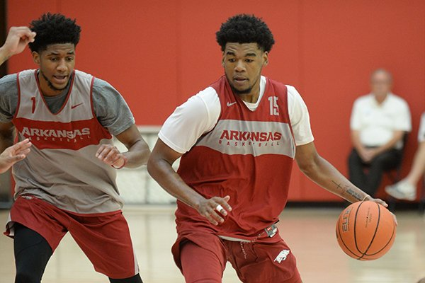 Arkansas guard Mason Jones (15) drives to the lane Thursday, Sept. 26, 2019, as guard Isaiah Joe defends during practice in the Eddie Sutton Gymnasium inside the Basketball Performance Center in Fayetteville.
