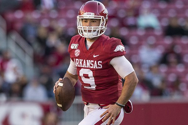 Arkansas quarterback John Stephen Jones looks to pass during a game against Mississippi State on Saturday, Nov. 2, 2019, in Fayetteville.