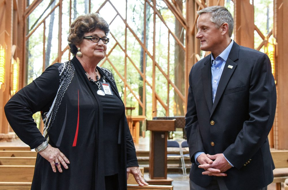 U.S. Rep. Bruce Westerman, R-District 4, talks to Peggy Clark, Fay Jones School of Architecture and Design at the University of Arkansas alumna, Thursday in Anthony Chapel at Garvan Woodland Gardens. - Photo by Grace Brown of The Sentinel-Record