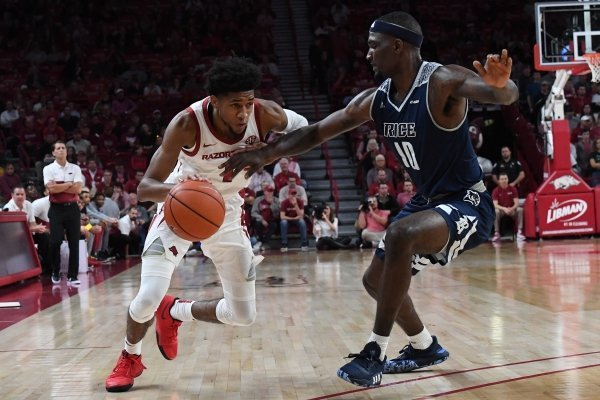 Isaiah Joe drives by a Rice defender during Arkansas' 91-43 win over the Owls on Tuesday, Nov. 5, 2019 during the Razorbacks' regular season opener at Bud Walton Arena in Fayetteville.