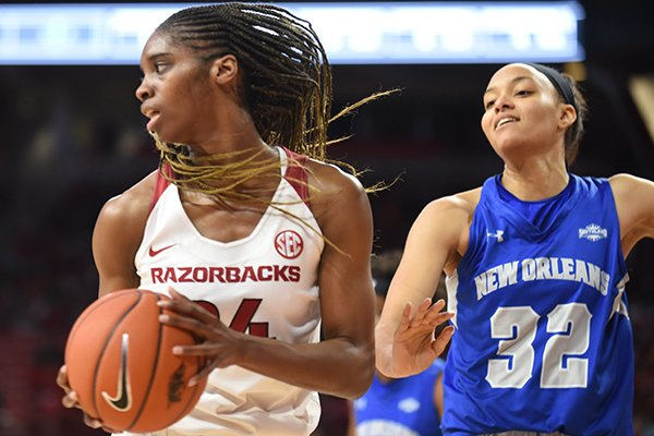 Arkansas forward Taylah Thomas (24) pulls down a rebound during a game against New Orleans on Friday, Nov. 8, 2019, in Fayetteville. Thomas recorded a career-high 21 rebounds, one shy of the school record for a single game.