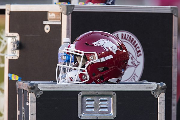 An Arkansas football helmet sits on the sideline during a game between the Razorbacks and Mississippi State on Saturday, Nov. 2, 2019, in Fayetteville.