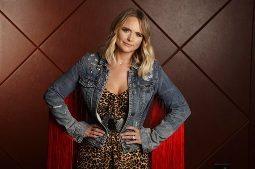 """This Oct. 9, 2019 photo shows country singer Miranda Lambert posing in Nashville, Tenn., to promote her latest album """"Wildcard,"""" available on Friday, Nov. 1. (AP Photo/Mark Humphrey)"""