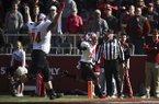 Western Kentucky's Devon Key (2) scores a touchdown on an interception return during a game against Arkansas on Saturday, Nov. 9, 2019, in Fayetteville.