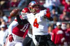Western Kentucky quarterback Ty Storey (4) throws a pass during a game against Arkansas on Saturday, Nov. 9, 2019, in Fayetteville.