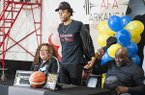 Moses Moody (center) reveals his commitment at Arkansas Fitness and Athletics in Little Rock on Saturday, Nov. 9, 2019, in Little Rock.