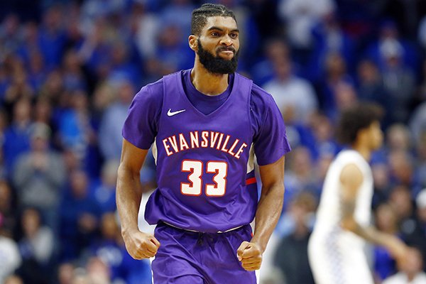 Evansville's K.J. Riley reacts after scoring late in the second half of the team's NCAA college basketball game against Kentucky in Lexington, Ky., Tuesday, Nov. 12, 2019. Evansville won 67-64. (AP Photo/James Crisp)