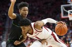 Arkansas guard Isaiah Joe (1) attempts to drive around North Texas guard James Reese (0) during a game Tuesday, Nov. 12, 2019, in Fayetteville.