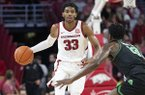 Arkansas guard Jimmy Whitt brings the ball up the floor during a game against North Texas on Tuesday, Nov. 12, 2019, in Fayetteville.