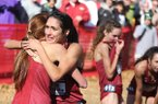 Arkansas' Taylor Werner (facing) hugs teammates after crossing the finish line during the NCAA South Regional on Friday, Nov. 15, 2019, at Agri Park in Fayetteville.