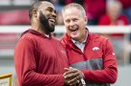 Arkansas athletics director Hunter Yurachek (right) laughs with former Arkansas running back Darren McFadden during a timeout of a game between the Razorbacks and Auburn on Saturday, Oct. 19, 2019, in Fayetteville. McFadden was being recognized for his election to the College Football Hall of Fame.