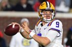 LSU quarterback Joe Burrow looks for a receiver during the first half of the team's NCAA college football game against Mississippi in Oxford, Miss., Saturday, Nov. 16, 2019. (AP Photo/Thomas Graning)